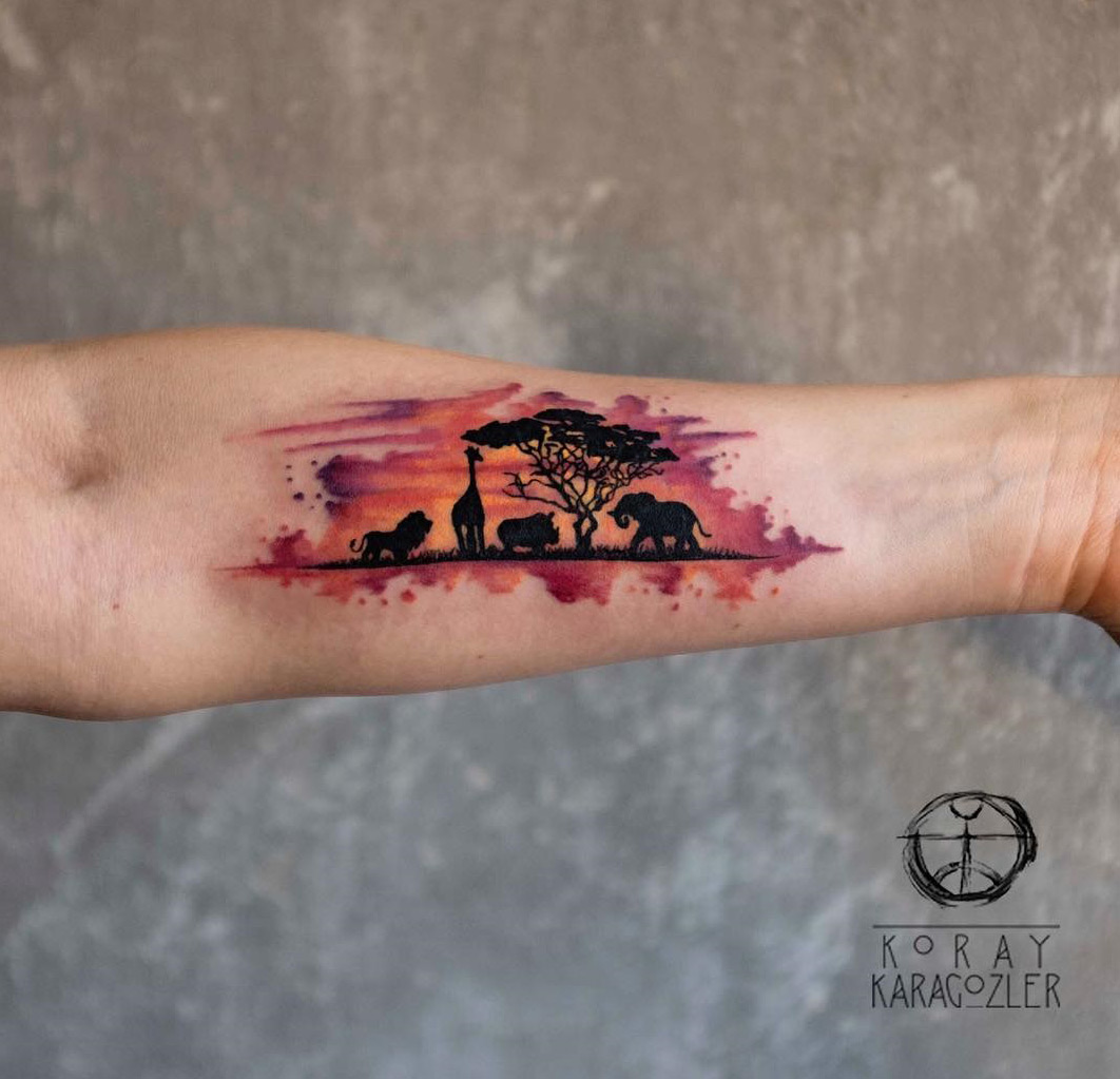 African animals watercolor arm tattoo
