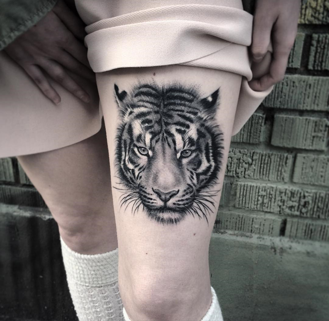 Fluffy tiger portrait on girl 39 s thigh best tattoo design for Tiger thigh tattoos
