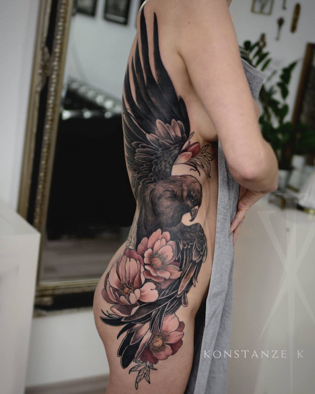 Golden eagle & peonies side tattoo