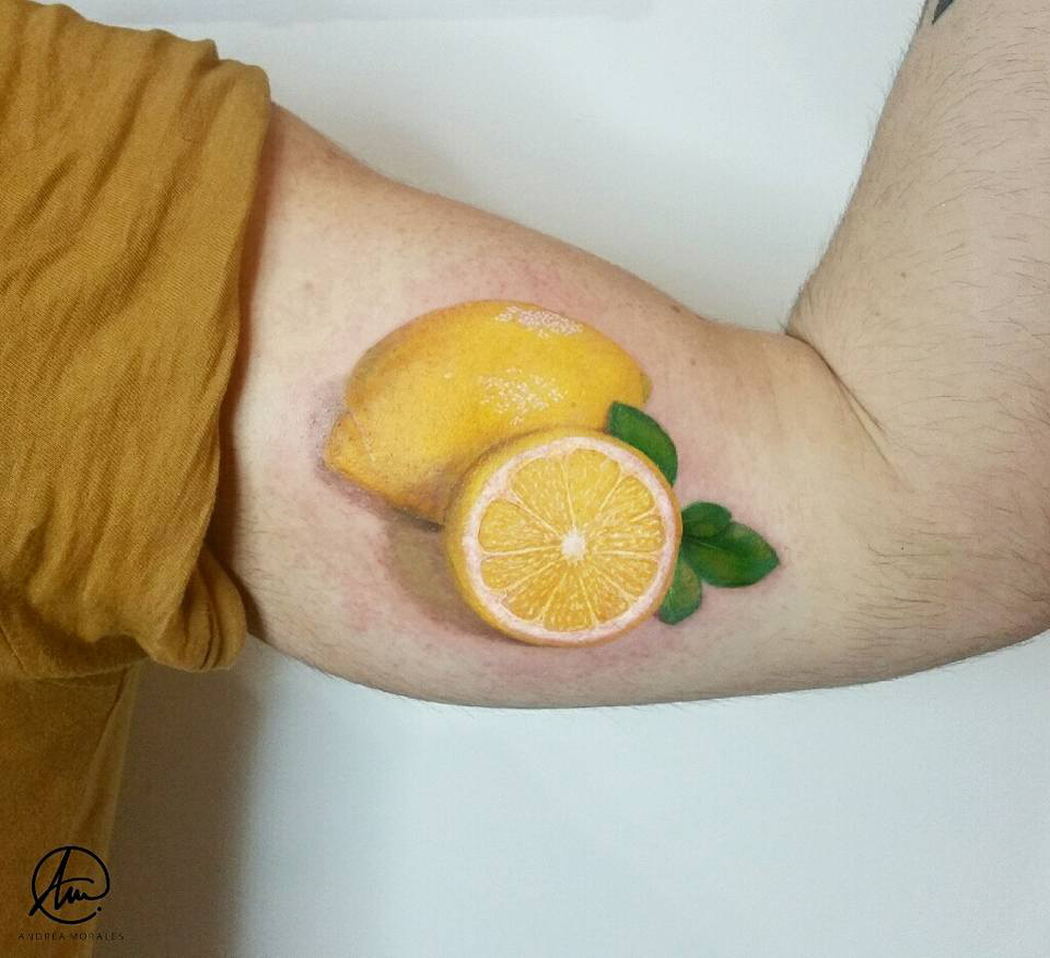 Lemon tattoo, realism men's bicep