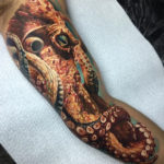Inner bicep Octopus realistic tattoo