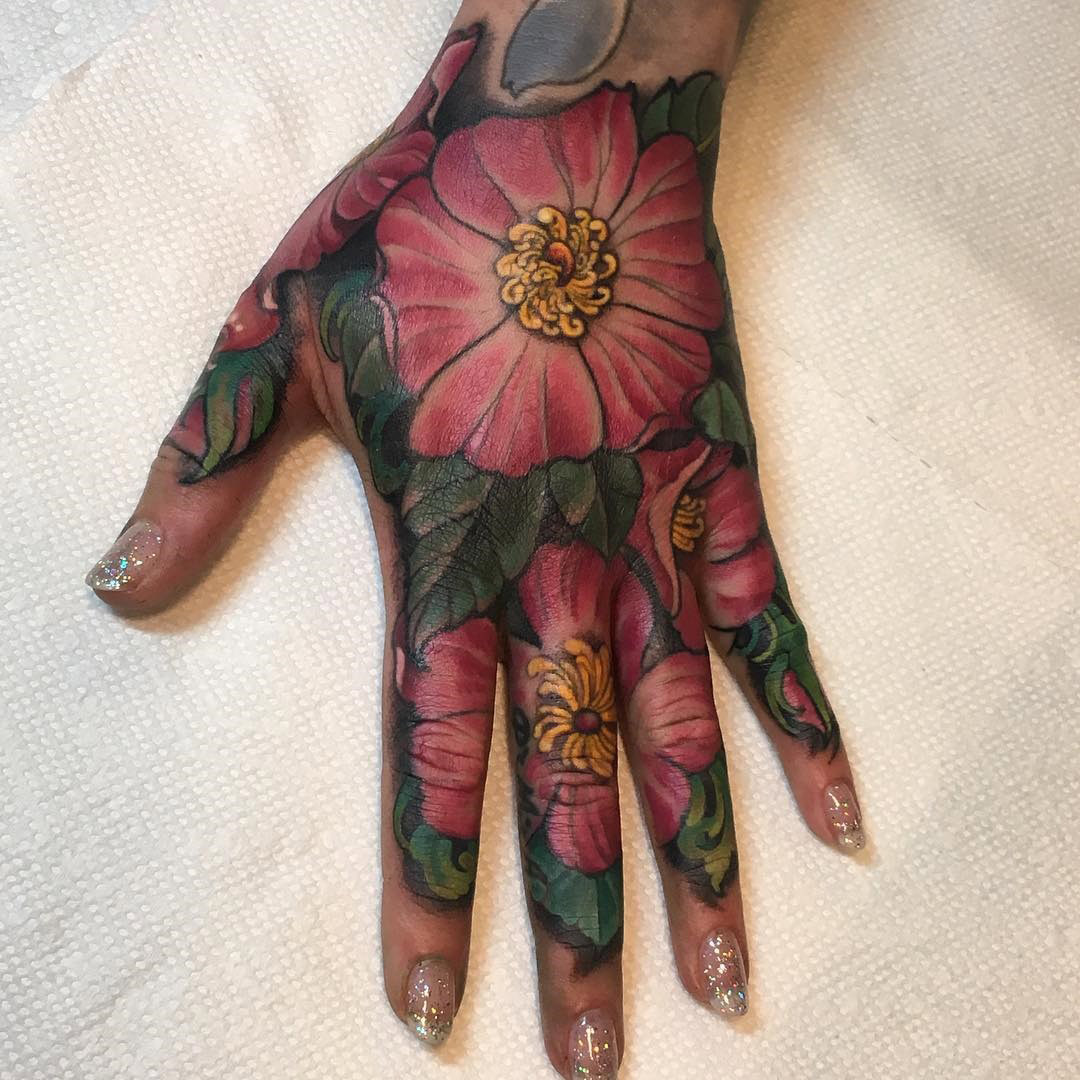 Wild Rose Girl's Hand Tattoo