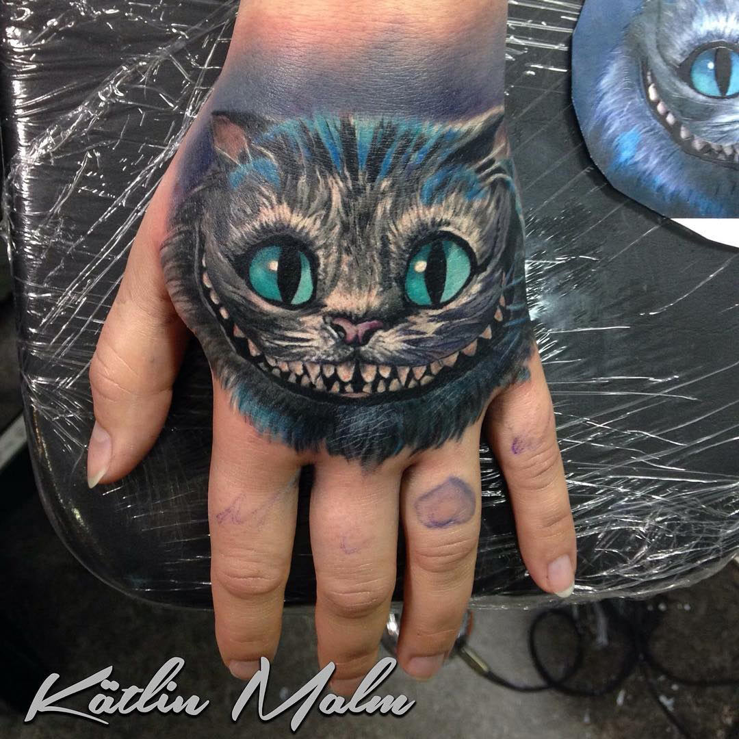 cheshire cat on girl 39 s hand best tattoo design ideas. Black Bedroom Furniture Sets. Home Design Ideas