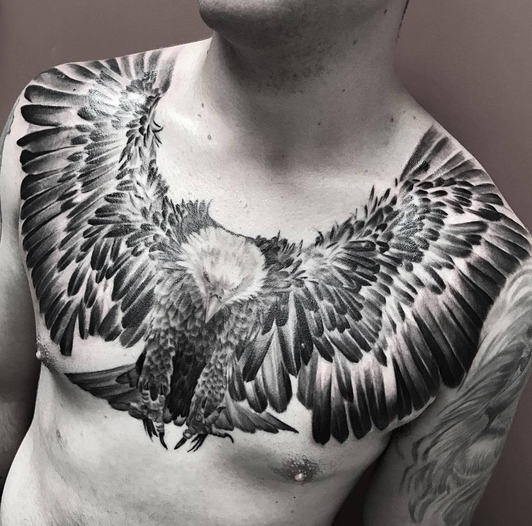 Flying eagle with talons ready mens chest tattoo best for Chest tattoo drawings