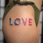 Love, word hip tattoo