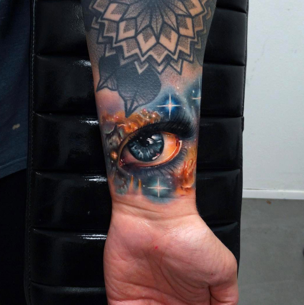Space Eye Tattoo On Guy's Wrist
