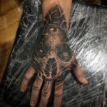 Cyber Illuminati hand tattoo
