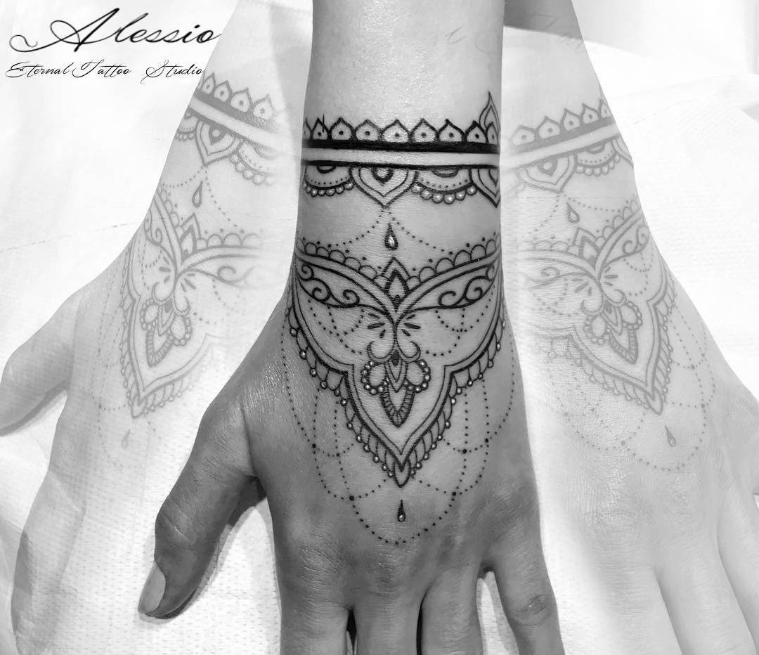 Ornamental Henna Hand Tattoo