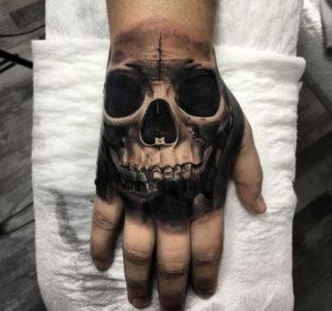 Realism Skull Hand Tattoo