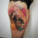Realistic lion's face tattoo