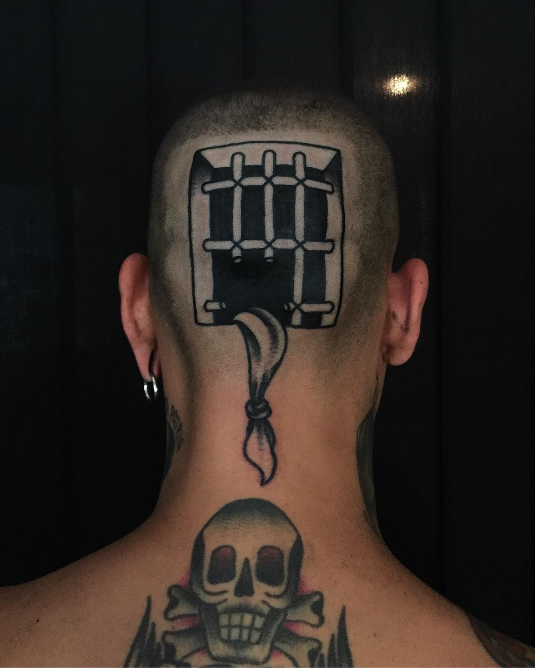 Prison escape head tattoo
