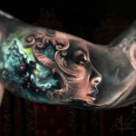 Galaxy Lady bicep tattoo