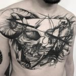 Abstract skull chest tattoo