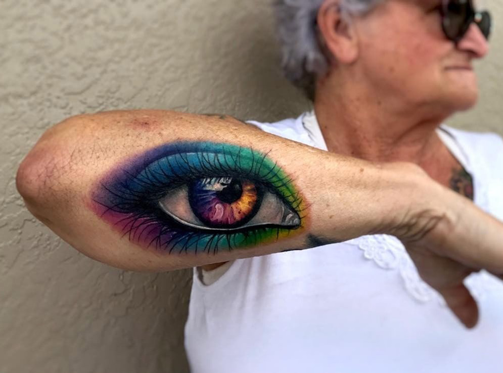 Magical eye tattoo, woman's forearm