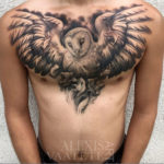 Owl, wings spread on mens chest