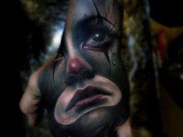 Sad Clown Hand Tattoo