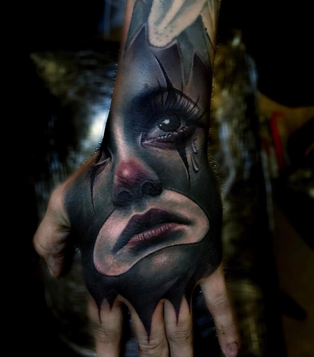 Sad Clown Hand Tattoo