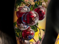 Red grapes arm tattoo