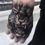 Tiger Hand Tattoo with orange eyes
