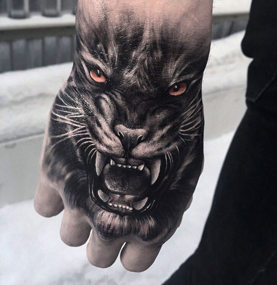 Tiger Hand Tattoo with orange eyes