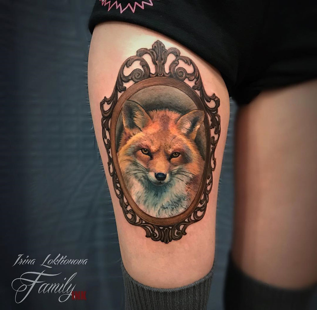 Fox Portrait on girl's leg