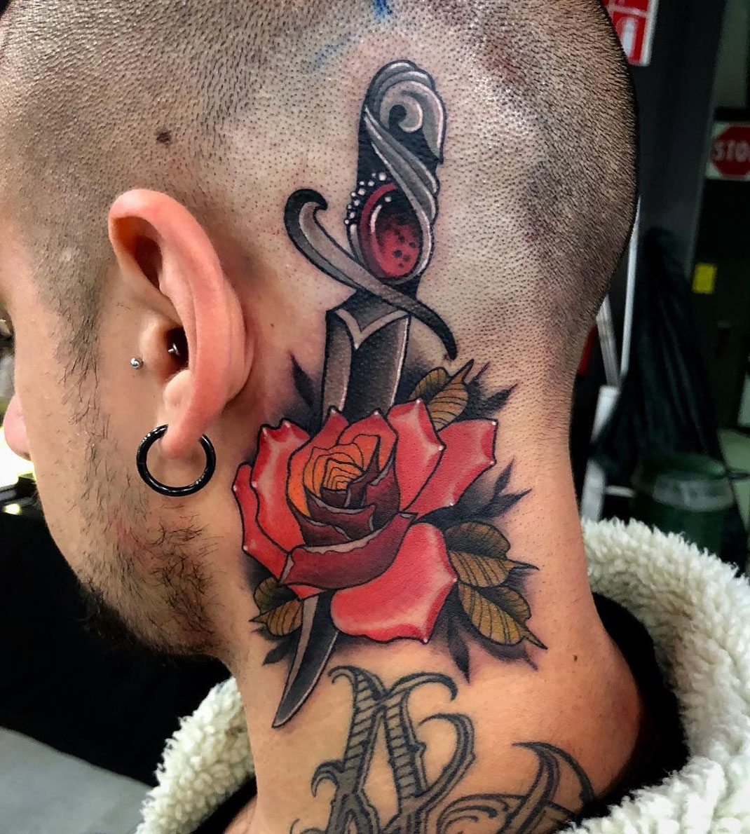 Rose & Dagger neck & head tattoo