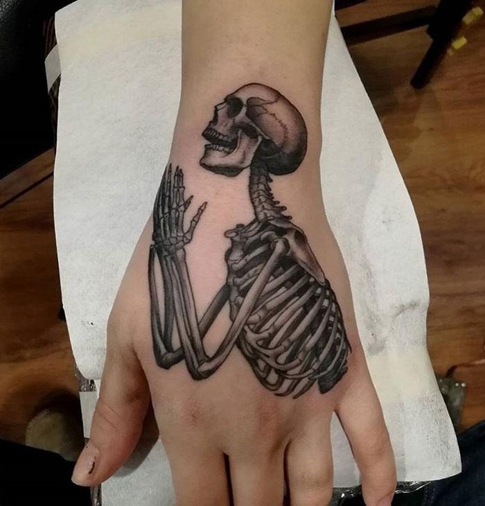 7c0005858 Skeleton at Prayer | Best tattoo design ideas