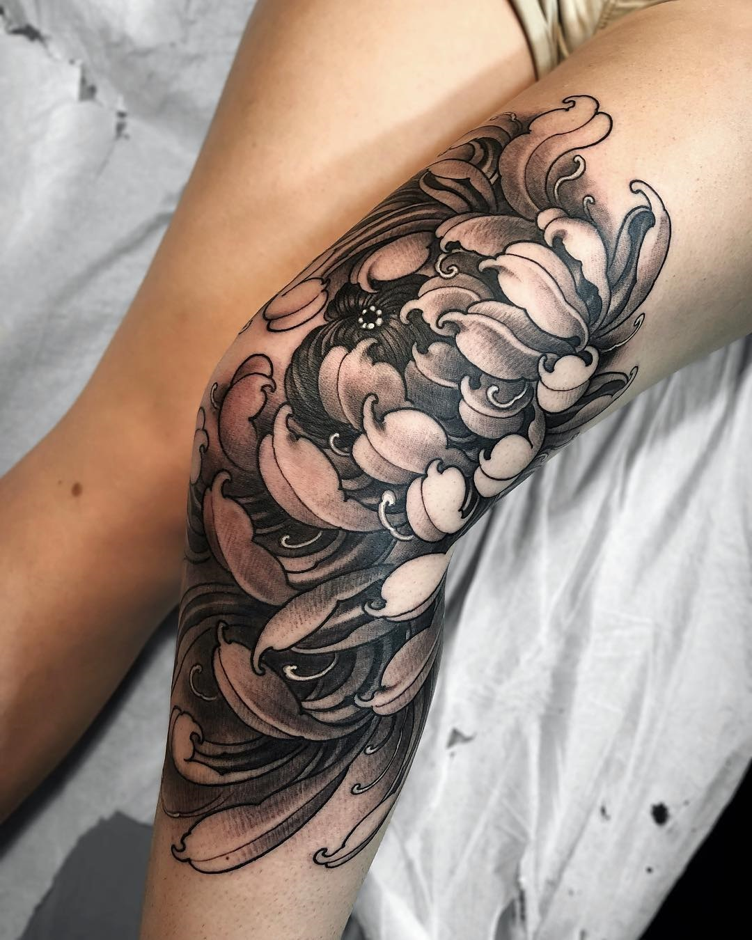 Chrysanthemum knee tattoo