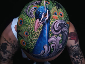 Peacock head tattoo