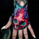 Pink skull & amethyst crystals hand tattoo
