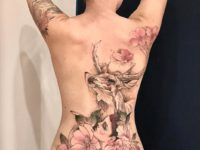 Watercolor deer & flowers back tattoo
