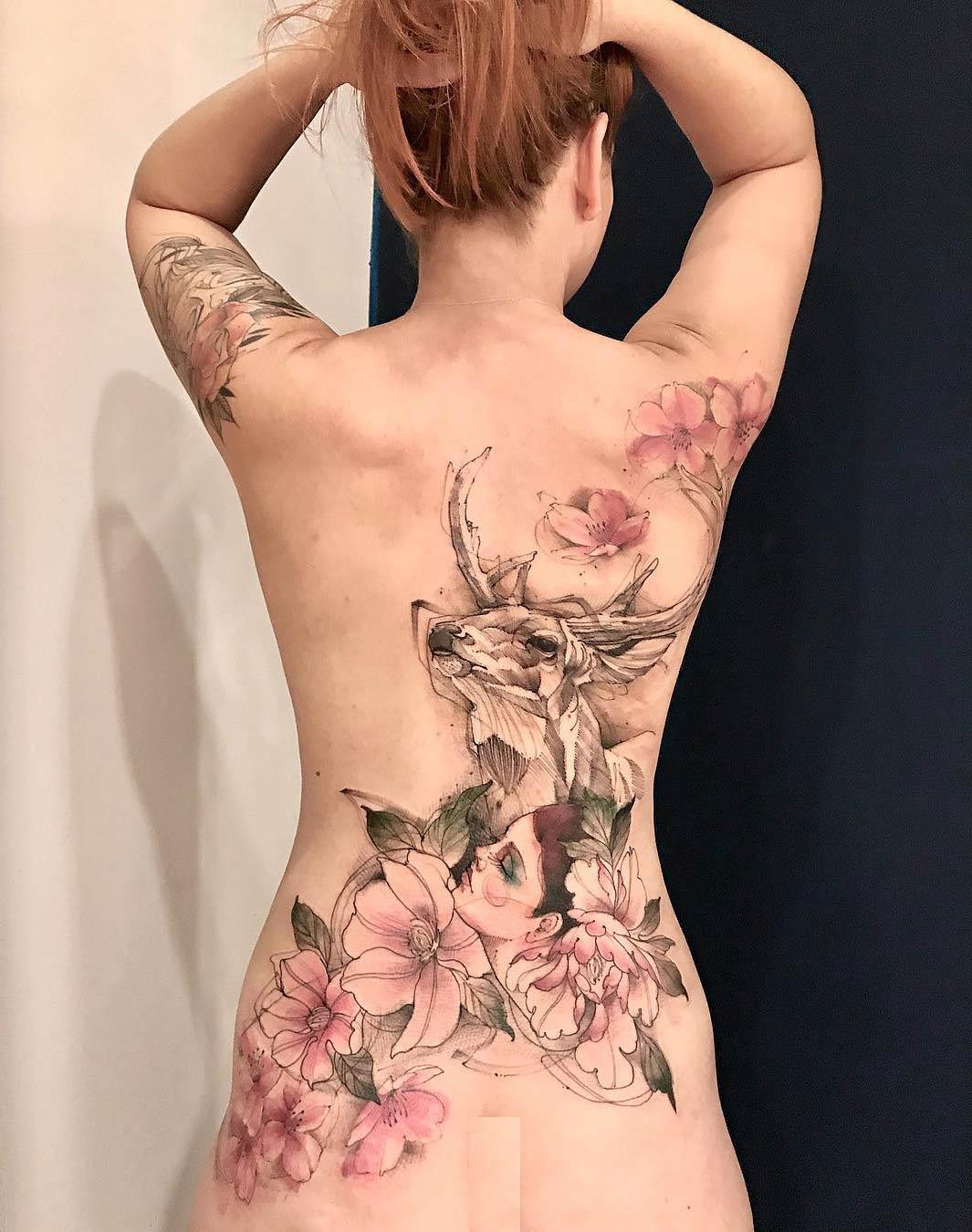 Watercolor deer & flowers back tattoo