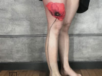 Realistic poppy leg tattoo