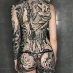 Filigree & rooster back tattoo