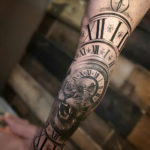 Clock & Lion Morph Tattoo