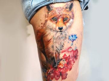 Watercolor fox leg tattoo