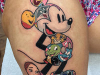 Disney characters thigh tattoo
