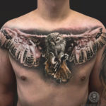 Flying Owl, men's chest tattoo