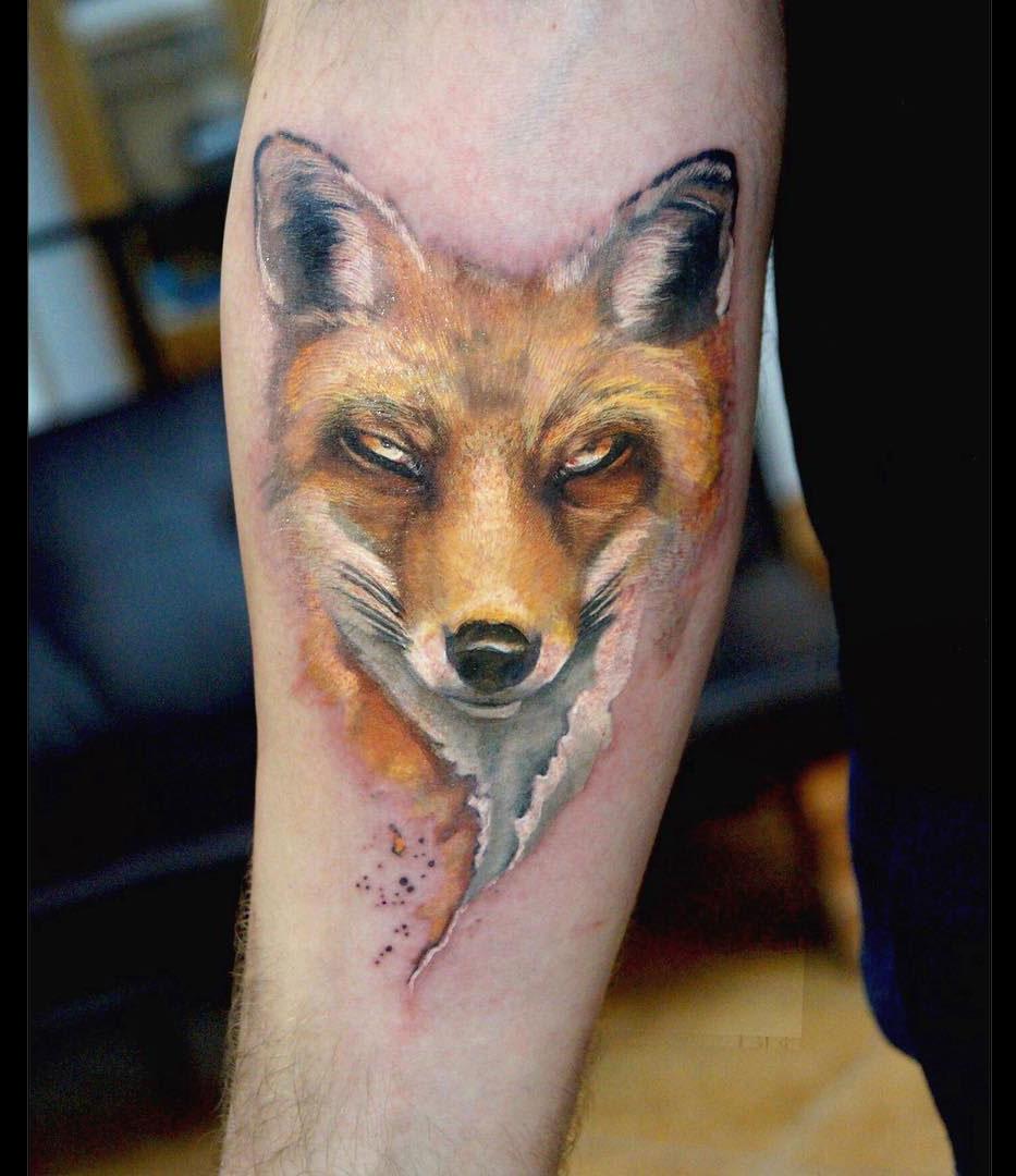 The Sly Fox, girls arm tattoo