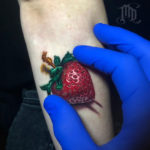 Strawberry arm tattoo