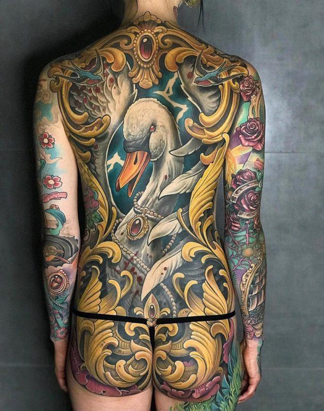Swan & filigree back tattoo