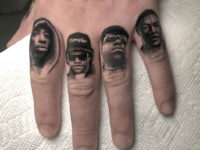 Rappers on guy's fingers