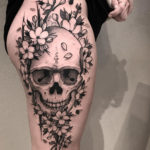 Skull & Flowers on girl's thigh