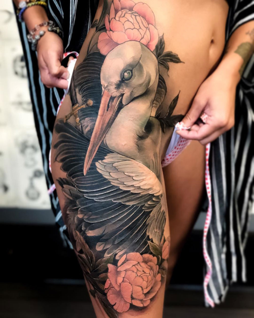 Stork & Peonies hip tattoo