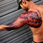 Wing back & arm tattoo