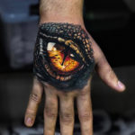 Dragon eye hand tattoo