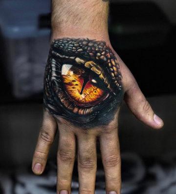 Dragon eye hand tattoo