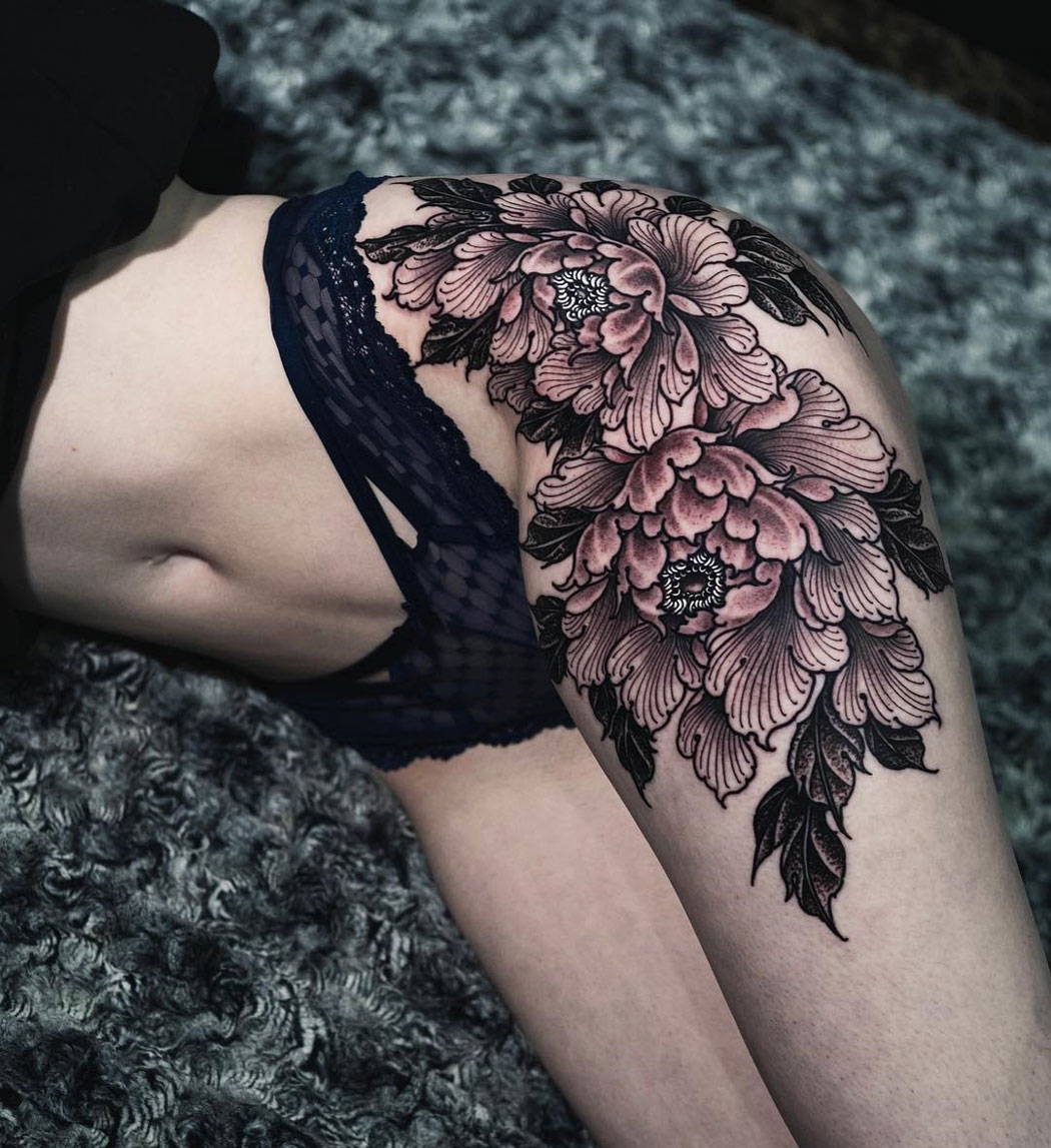 Peonies thigh tattoo
