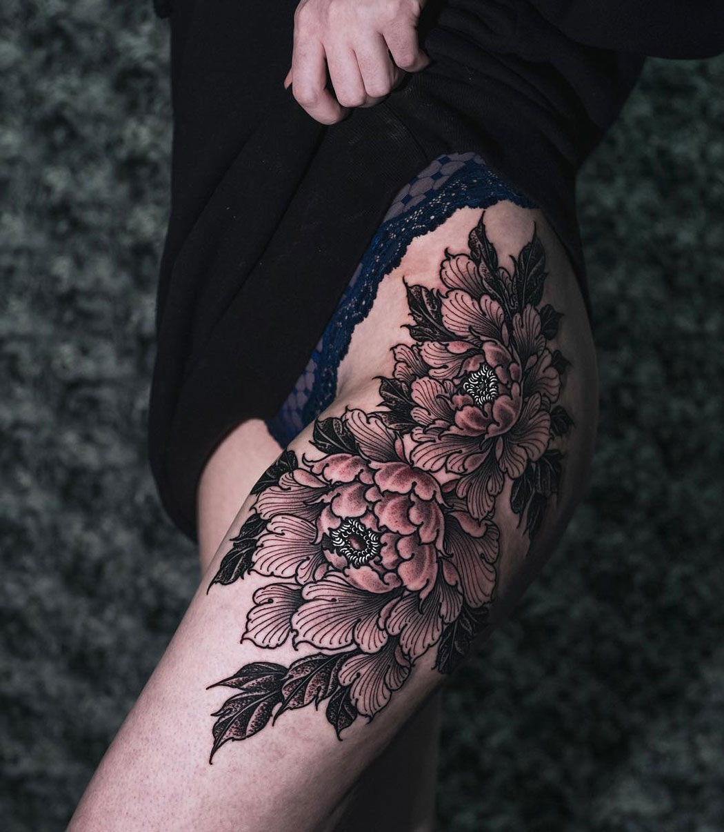Peonies on girl's thigh