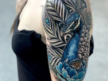 Peacock realism, girl's upper arm